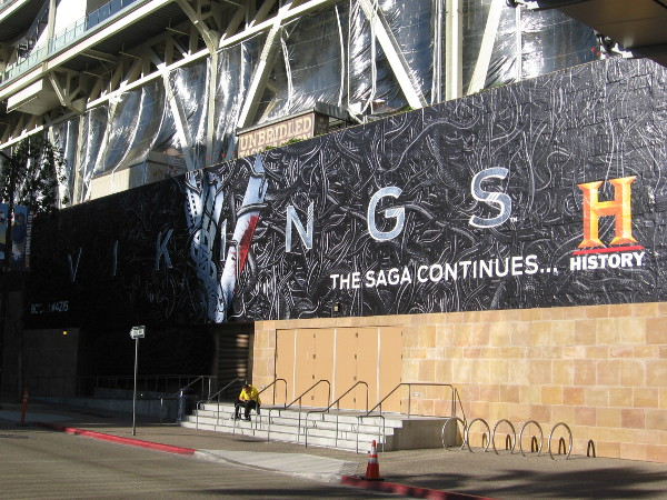 Like in years past, a big Vikings wrap has been applied to the west wall of Petco Park. I snapped this photo half in shadow, half in bright sunlight.