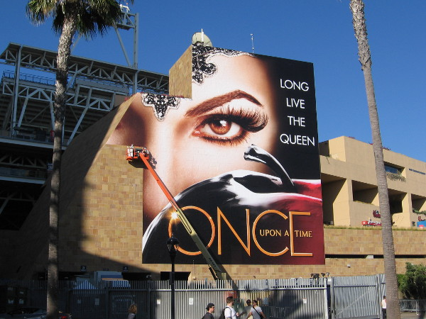 Another huge wrap being applied to a section of Petco Park promotes Once Upon A Time.