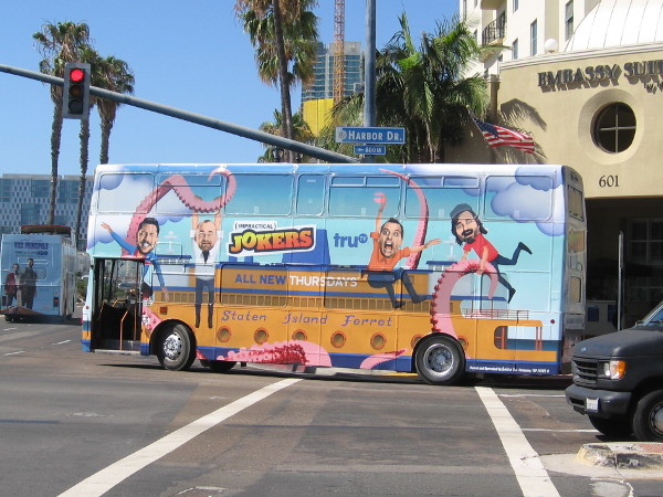 Various double-decker buses are going around decorated with big flashy wraps. This one promotes Impractical Jokers on the truTV channel.