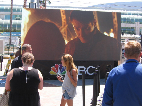 The video screen near the Tin Fish and the center of Comic-Con outdoor action is now operating.