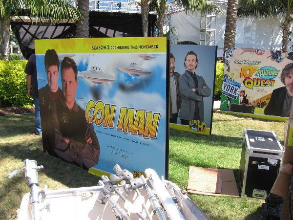 A number of promotional signs are arranged along the walkway where thousands of Comic-Con fans will pass in the next four days.