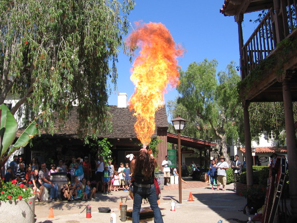 Is it Fire Lad of the Legion of Substitute Superheroes? No. It's Murrugan the Mystic performing at Seaport Village. That flame is coming from his mouth! You might remember him on AMC's Freakshow. He's working to keep the carnival sideshow--a part of Americana-alive.