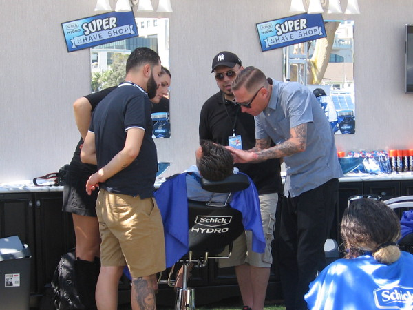 Schick is at Con-X giving free shaves. Now that is some close attention!