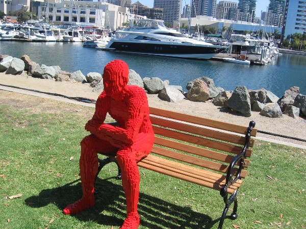 I found a silent, thoughtful man built of red Legos just sitting on a bench at Con-X. The Art of the Brick is coming soon to San Diego's Reuben H. Fleet Science Center. Cool!