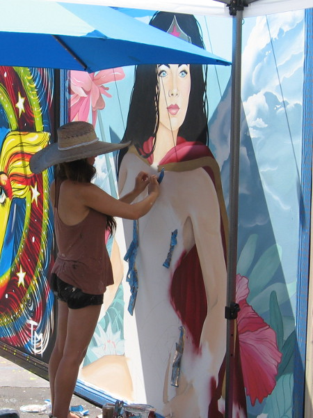The center panel honoring Wonder Woman is being painted by another talented San Diego artist, Celeste Byers.
