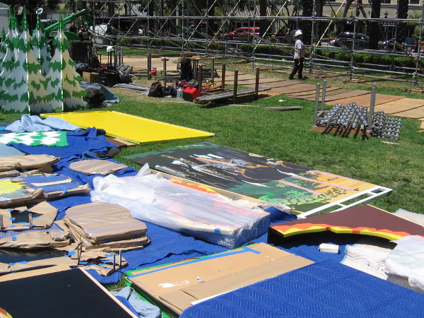 Spread all over the grass, literally dozens of panels of fun artwork are waiting to be installed at the South Park 20 Interactive Fan Experience. A huge backdrop is being assembled by workers this very moment.