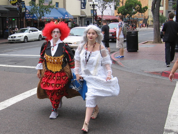 I was told these ladies are characters from Alice in Wonderland. It appears to me one is the Queen of Hearts and the other Alice.