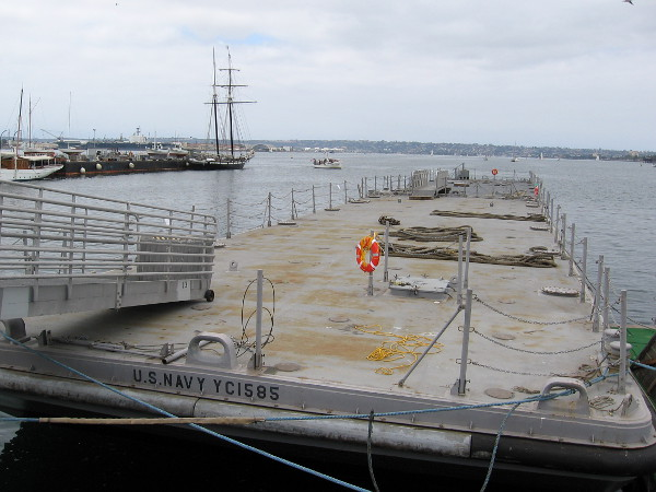 One of several U.S. Navy floating docks has been set in position near the Maritime Museum of San Diego, in preparation for the 2016 Festival of Sail.