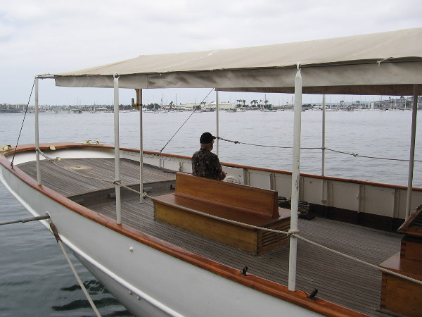 Visitor to the Maritime Museum of San Diego sits peacefully on a bench near the aft of the 1904 steam yacht Medea. Big crowds will arrive on Labor Day weekend!