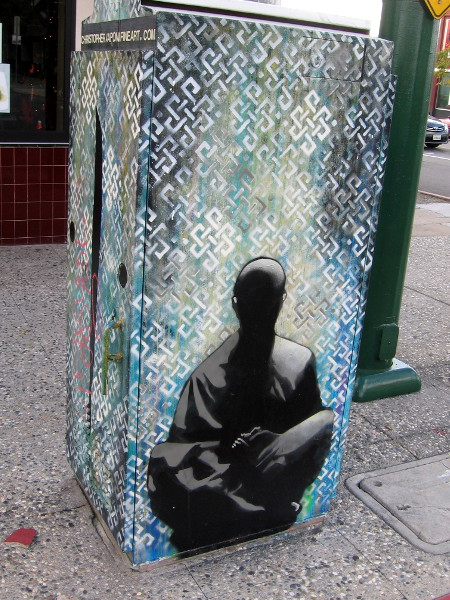 North Park utility box depicts meditating figure.