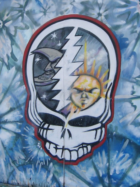 Lightning inside a deadhead skull separates night from day. Urban art on a shop located on North Park's University Avenue.