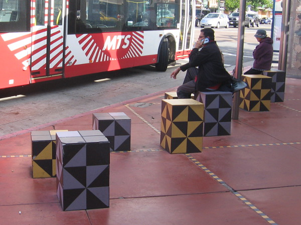 These artistic cubes are fun seats for people waiting for the bus.