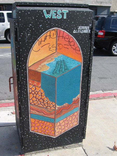 One unique utility box has four sides featuring subterranean slices. West shows where land meets Pacific Ocean.
