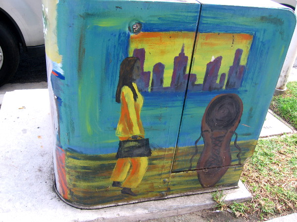 Street art in North Park shows a woman walking through the city.
