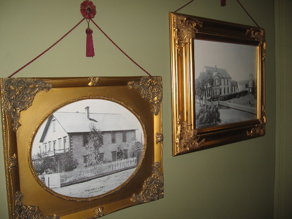 Framed photo on one wall from the San Diego Historical Society shows the original McCoy House.