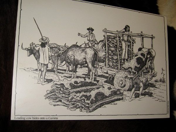 Illustration of loading cow hides onto a carreta. Hides were gathered by ships along the coast to be transported around Cape Horn to the eastern United States.