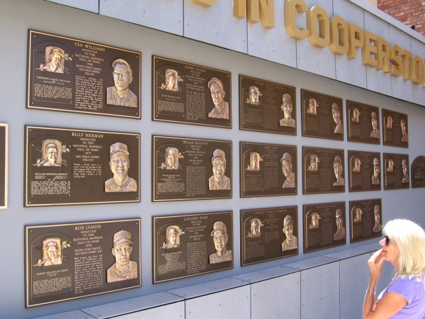 Legends who played baseball with the San Diego Padres who are now in Cooperstown's National Baseball Hall of Fame include Ted Williams and Willie McCovey.
