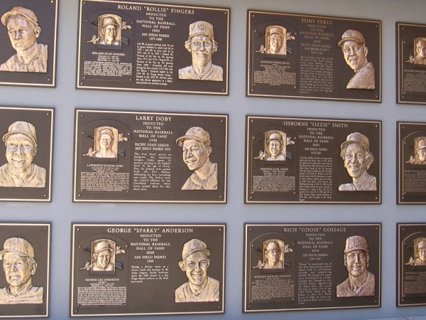 A wall at Petco Park is dedicated to Padres coaches and players who are now in the National Baseball Hall of Fame. Names include Rollie Fingers, Ozzie Smith, Rickey Henderson, Goose Gossage.