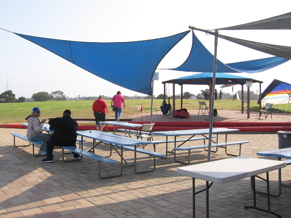 A quick photo through the Torrey Pines Gliderport's casual patio area, with picnic benches. I spotted an outdoor grill and pool table nearby!