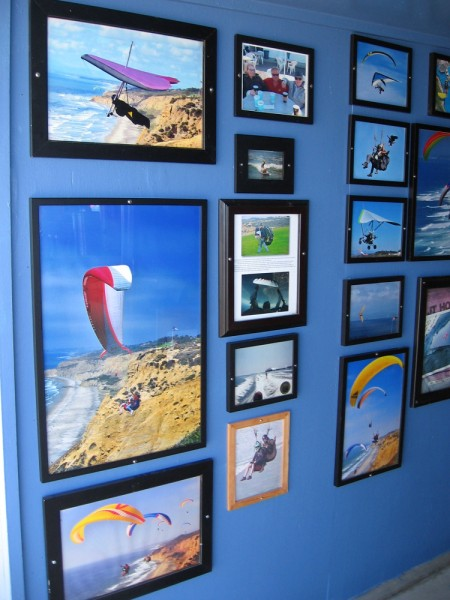 A short hallway that leads into the Torrey Pines Gliderport store features many photos of past hang gliding and paragliding action.