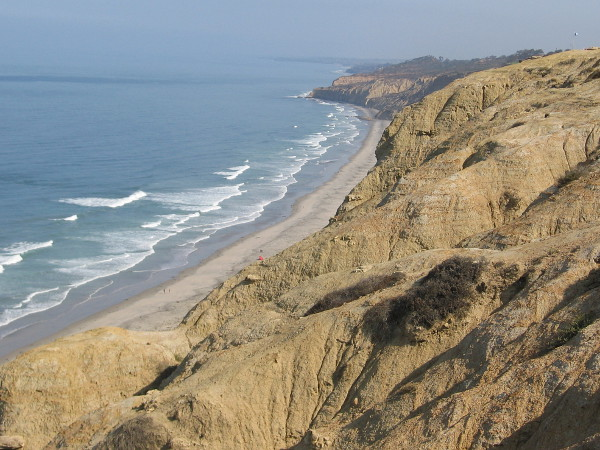Another look north at beautiful high cliffs of eroded sandstone. The coastline melts away into San Diego's North County.