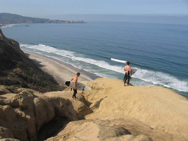 A couple of surfers prepare to descend the cliff to Black's Beach far below. For those who don't follow the established trail, it can be a very treacherous descent, and one occasionally sees rescues on the local news.