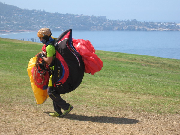 Carrying all the paragliding gear back up the hill. When actually gliding, if too much elevation is lost, some gliders will land on the beach. Then the climb is much, much worse!