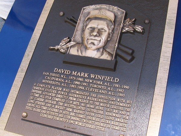"Dave Winfield played for the San Diego Padres from 1973 to 1980. A talented outfielder, he swung the bat with incredible power. A special plaque for him now stands in front of the ""Padres In Cooperstown"" wall at Petco Park."
