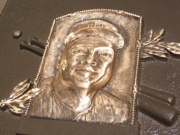 """The smiling face of Tony Gwynn on a very special plaque. It stands proudly in front of the """"Padres In Cooperstown"""" wall at Petco Park."""