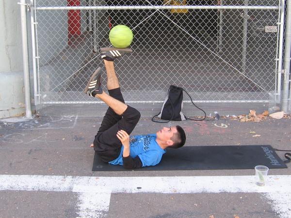 Street performer balances a ball at Navy Pier.