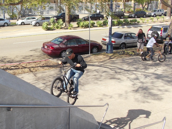 A bicyclist with a daring spirit at the Harbor Drive pedestrian bridge.