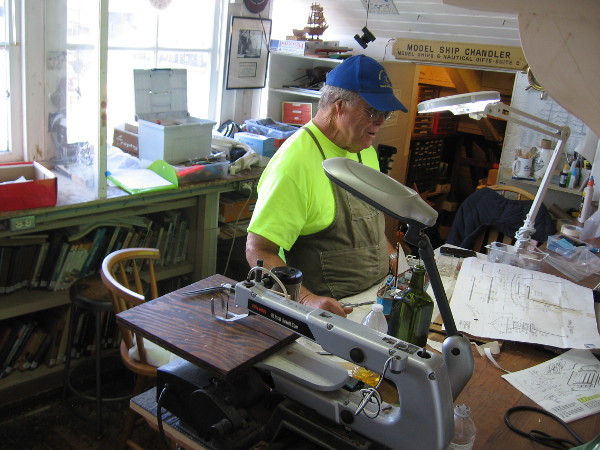 Master craftsman works in the Model Shop of the Maritime Museum of San Diego. The magical place is located inside the steam ferry Berkeley.