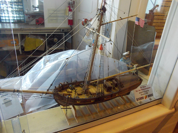 A finished model of ARMD Virginia Sloop 1768 intricately made to replicate an actual historical vessel.