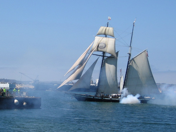 Tall ship Californian fires a cannon toward the Maritime Museum of San Diego during the 2016 Festival of Sail!