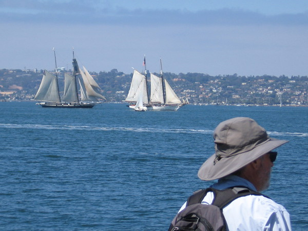 The 2016 Festival of Sail includes dueling tall ships out on San Diego Bay. Here we see Californian and Bill of Rights maneuvering to fire some broadsides.