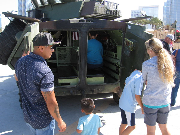 Visitors at 2016 Fleet Week on the Broadway Pier peer inside an LAV-25A2 Light Armored Vehicle.