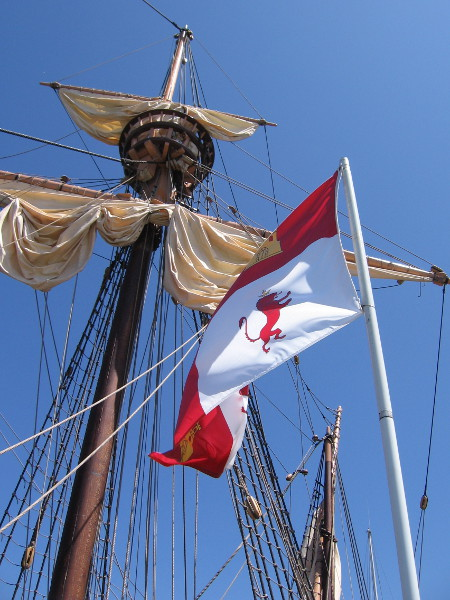 Looking up at masts, a crow's nest, and a flag of the Spanish Empire while waiting to board the San Salvador. This ship is an approximate replica of what Juan Rodriguez Cabrillo sailed in when he discovered San Diego Bay in 1542.