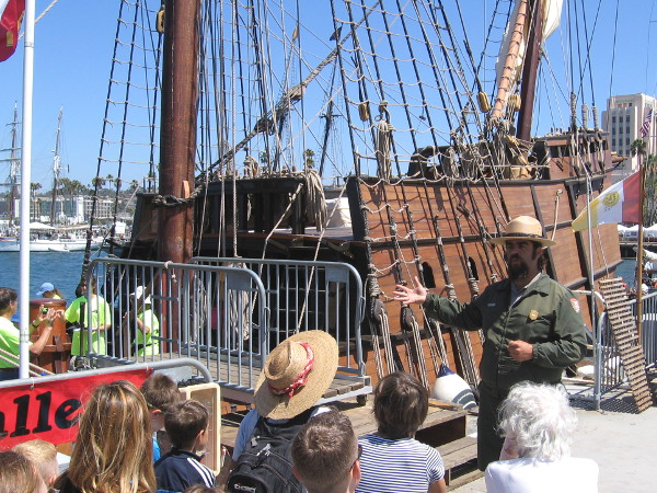 A park ranger from Cabrillo National Monument, across the bay on Point Loma, talks to visitors about the history of the San Salvador and the difficulties of sailing long ago.