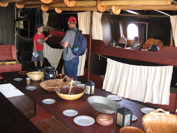 Exhibits on the San Salvador replica galleon include a crude narrow dining table and armor used by Spanish conquistadors.