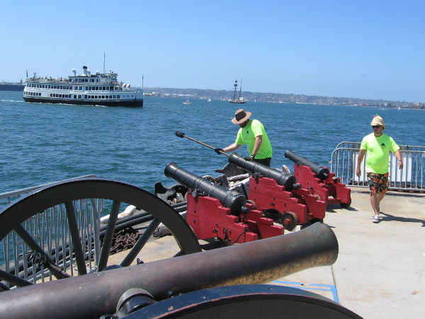 Out at the end of the Maritime Museum of San Diego's dock, three cannons are prepared to be fired!
