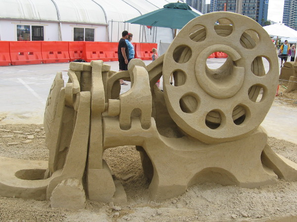 The Rockin' Bobbin, which resembles a machine with many parts, is a wonderful example of complex sand art.