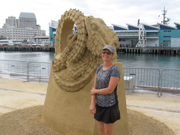 The friendly world-class sand sculptor Susanne Ruseler poses for photos by her fantastic artwork.
