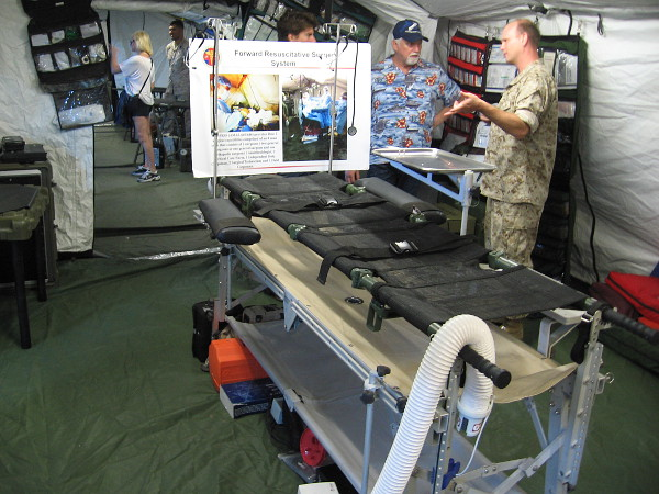 Inside the Port Pavilion, an extensive exhibit demonstrates medical facilities that would be set up near an area of combat. This is a surgical tent.