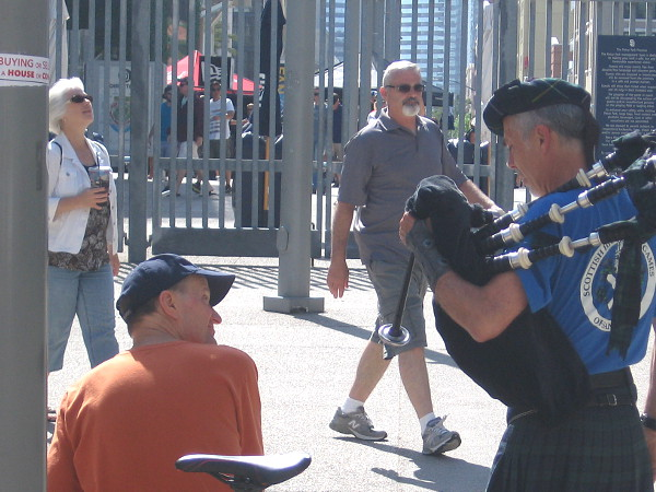 Bagpipes and a smile outside Petco Park.