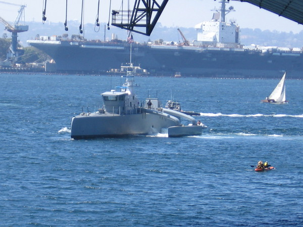 According to my Fleet Week program, I believe this is an ACTUV, or Anti-Submarine Continuous Trail Unmanned Vehicle. In the background, at North Island, I see the aircraft carrier Theodore Roosevelt.