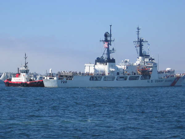 The Coast Guard's USCGC Sherman endurance cutter is given a bit of assist by a tug boat as it comes into dock during the Sea and Air Parade.