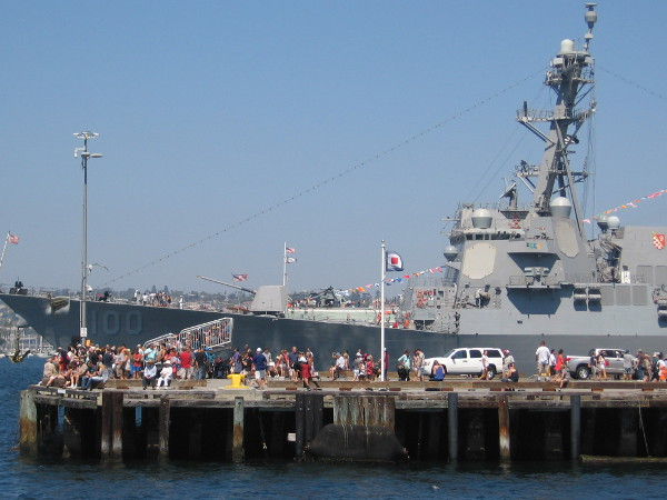 Lots of people watch the action on San Diego Bay from the end of the Broadway Pier. USS Kidd is in the background, hosting public tours from the B Street Pier.