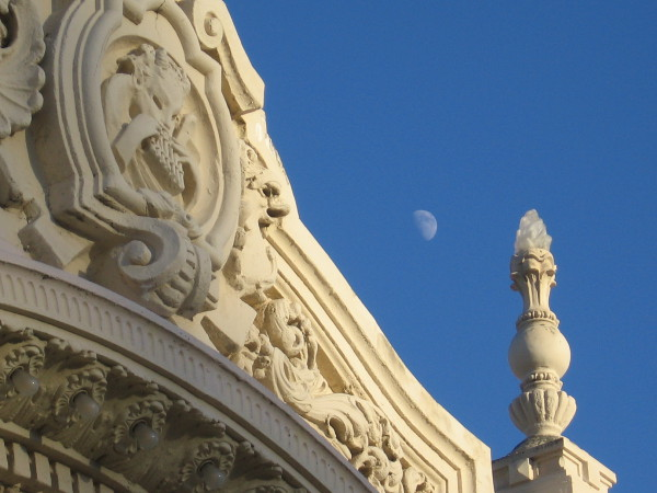 A half moon hangs above the ornate colonnade of the Spreckels Organ Pavilion. Very appropriate!