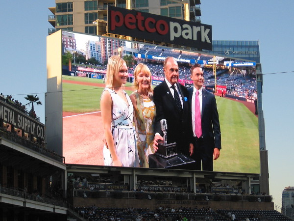 Dick Enberg receives honors during a ceremony on the field before his final home Padres ball game. Here he is seen with his family.