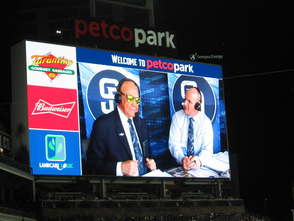 Dick Enberg sports cool sunglasses during a Padres baseball broadcast alongside Mark Grant.